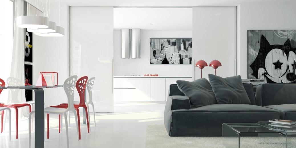 ampi scorrevoli in vetro laccato dividono la zona soggiorno pranzo dalla cucina e le ampie vetrate hanno lo scopo di catturare quanta pi luce possibile